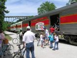 Bike riders take advantage of the Bike Aboard program and load bikes onto the Cuyahoga Valley Scenic Railroad (CVSR) train at Brecksville station.