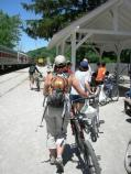 Cyclists making use of the Bike Aboard! program wait for the Cuyahoga Valley Scenic Railroad (CVSR) train at Peninsula Station.