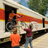 Cyclists load their bicycles on a Cuyahoga Valley Scenic Railroad (CVSR) train.