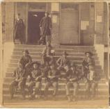 This photograph was taken before 1888 and shows prisoners posed on the steps of the federal courthouse.