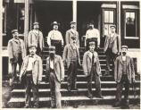 These jailers and guards are posed on the steps of the old federal courthouse, adjacent to the jail wing that was built in 1888. This photo was taken after 1889.