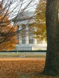 The Clark memorial seen through the branches of fall trees.
