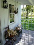 Hanging herbs and corn adorn the back porch of the Birthplace Cottage.