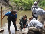 Volunteers conduct water quality monitoring