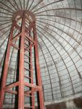 Inside of arched dome, showing recently added reinforcing verticle framework that supports the middle of the dome. Interior of the dome shows concrete with ribbing.