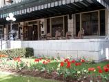 The tulip bed in the yard compliments the flower bed at the foundation of the historic Fordyce Bathhouse.
