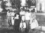 Harry Truman and Bess Wallace with friends at Waterworks Park near Sugar Creek, Missouri, October 1913. L to R: William Rugg, Nell Rugg, Frank Wallace, May Southern, Julia Rugg and Bess Wallace. Harry Truman seated in front. Harry S. Truman Library 82-58-14.