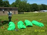 Firefighter oversees the training on the use of fire shelters and their deployment