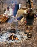 American Indian demonstrators boil sap using clay, rocks and hollowed out logs to make maple sugar.