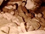 A group of cave explorers rests during an exploration trip