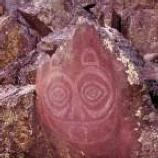 Native face painted on rock