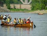 Canoeing the Mississippi River in Wilderness Inquiry canoes. NPS rangers and Wilderness Inquiry staff stern the boats and keep up a lively discussion about life along the river.