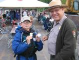 The best part of becoming a Junior Ranger is the experience of being on the river, but getting your badge is also important. In this photo Ranger David gives a new Junior Ranger a badge for learning about the Mississippi River and its importance.