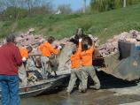 Inmates from South Dakota Dept. of Corrections Yankton Trustee Unit unload trash from boat.