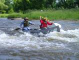 Canoeists run the rapids at high water.
