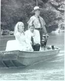 Tricia Nixon is treated to a ride on the Current River with a park ranger. Ms Nixon presided over the park's dedication ceremonies in 1970.