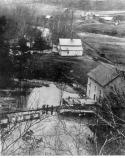 An old view of Alley Mill taken from the bluff above. The mill, dam and spillway are all visible.