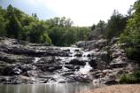 Rocky Falls on Rocky Creek is located about ten miles east of Eminence, MO.