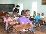 A park ranger portrays a teacher in the Storys Creek School.