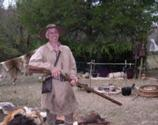 Man re-enacts frontier life from the time of the long rifles.