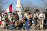 Living historians participate in a procession at the battle monuments near the Elkhorn Tavern at the 145th Battle Anniversary.
