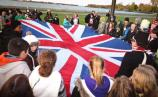 Students help fold British flag