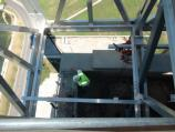 Looking down on demolition of parapit wall on observation deck