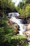 Sable Falls rolls down several sections of Jacobsville sandstone on its way to Lake Superior.