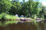 Campsites are located along the river. They are available on a first come basis to canoers and boaters.