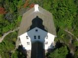 This photo shows the Lighthouse Keeper's residence from the top of the lighthouse with the shadow of the lighthouse centered on the residence.