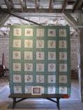 Embroidered wildflowers quilt