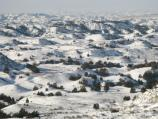 Snow covers the badlands in a view from Boicourt Overlook along the South Unit's 36-mile Scenic Loop Drive.