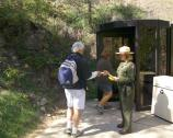 A ranger takes tickets at Wind Cave's walk-in entrance. Tours of Wind Cave are offered year-round.