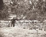 Photo taken September 21, 1862, at Burnside Bridge, showing graves of Union soldiers who were killed while taking the bridge. The graves are marked with crude wooden markers.