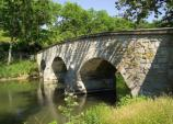 The Burnside Bridge was named after Union General Ambrose Burnside who commanded the Ninth Corps at Antietam. His soldiers made repeated attacks against the small force of Confederates who defended this crucial Antietam Creek crossing.