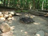 A combination campfire pit and cooking grill is available at each cabin in Camp Misty Mount.
