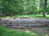 The campfire circle at Camp Misty Mount is available and may be reserved by interested groups when cabin reservations are made.