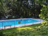 A swimming pool is available to campers during the summer. No lifeguard.