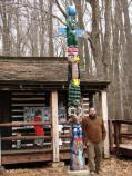 Artist Erin Aylor poses with the newly dedicated totem pole in Camp Greentop, April 1, 2006.