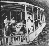 People gather for a dinner on a canal boat.