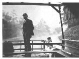 Man on Deck of boat on the canal