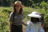 Ranger Emily helps a future bee keeper learn about pollination