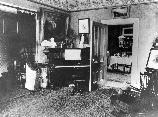 Photograph of west parlor (the informer of family parlor) of the Frederick Douglass Home about 1895. FRDO 3137