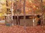 a picture of the changing colors in the Greenbelt campground with the bathroom in background