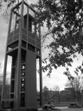 Modernist bell tower with flower beds and bronze lions