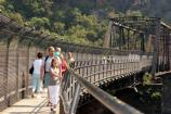 Visitors cross the pedestrian footbridge that links WV and MD