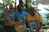 Alan Spears, NPCA, makes a special presentation to Todd Bolton, left, and George Rutherford, right.