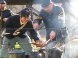 Soldiers and their meal. Scenes from Capt. Flagg's US Quartermaster City: Approach of Peace 1864 Event, Dec. 3-4, 2011. NPS Photo