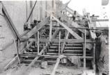 Workers building stairs up to the Grand Terrace.