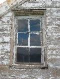 4) Window exemplifies deteriorated condition of structure prior to repairs